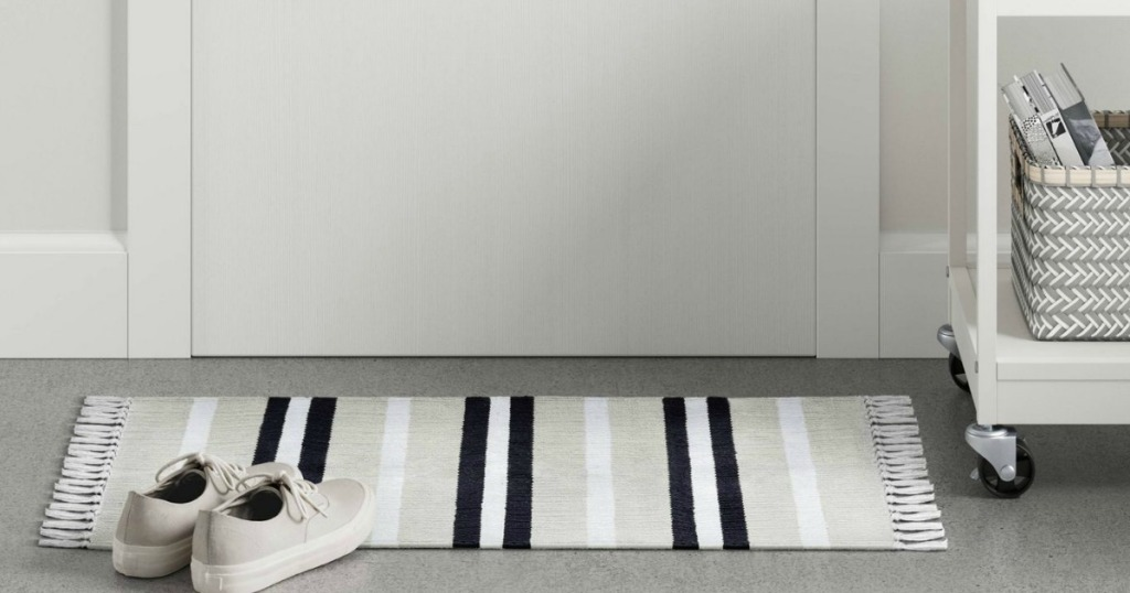 striped woven accent rug with shoes