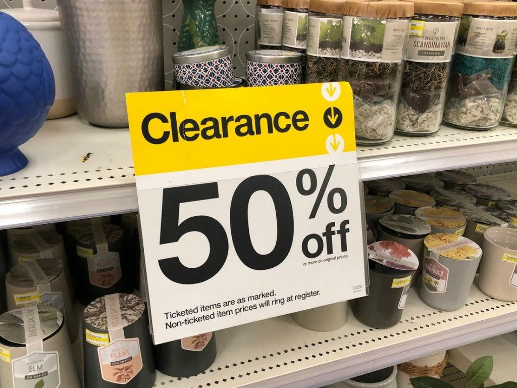 yellow and white clearance sign on store shelf