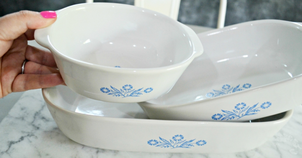 hand holdig vintage corningware bowl