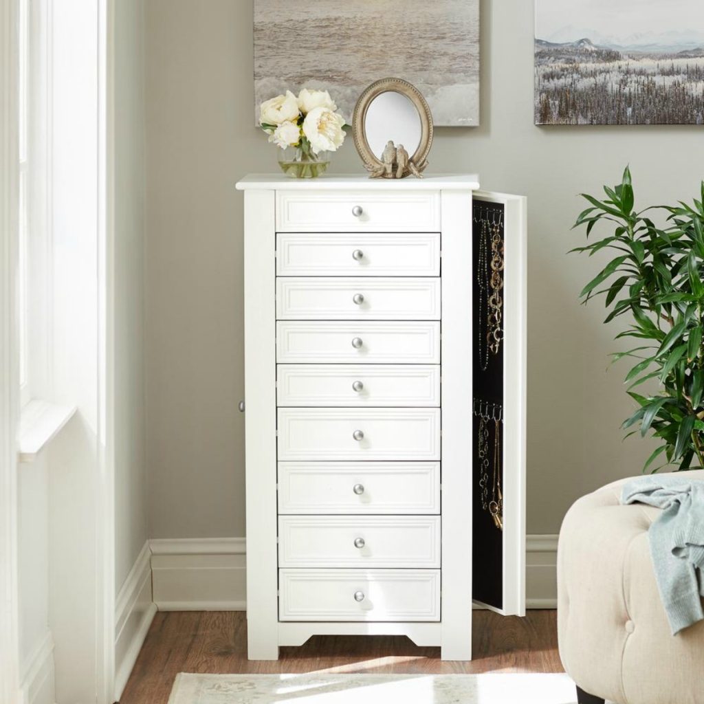white jewelry armoire in room