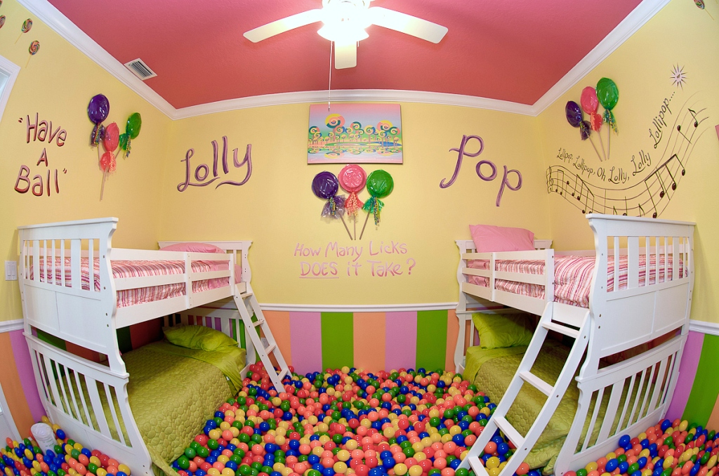 kids room with balls and bunk beds