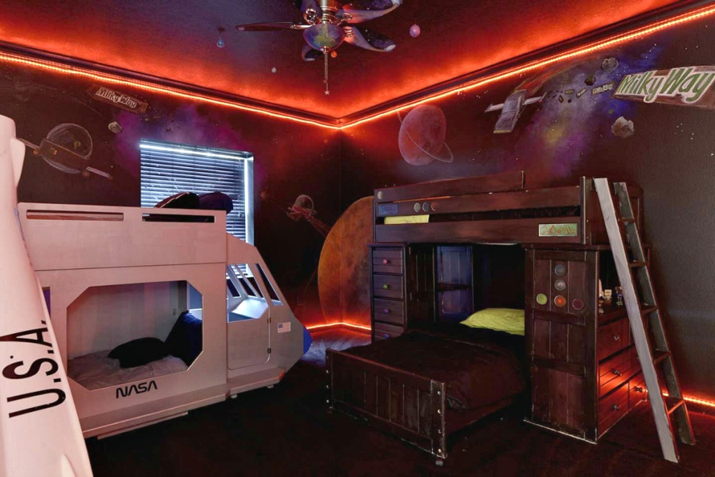 bed room with bunk bed and space theme