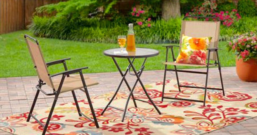 bistro set on patio with outdoor rug