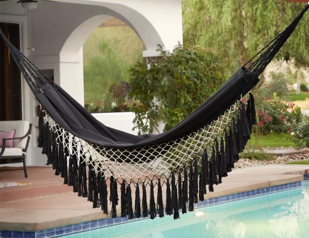fringe hammock hanging by pool