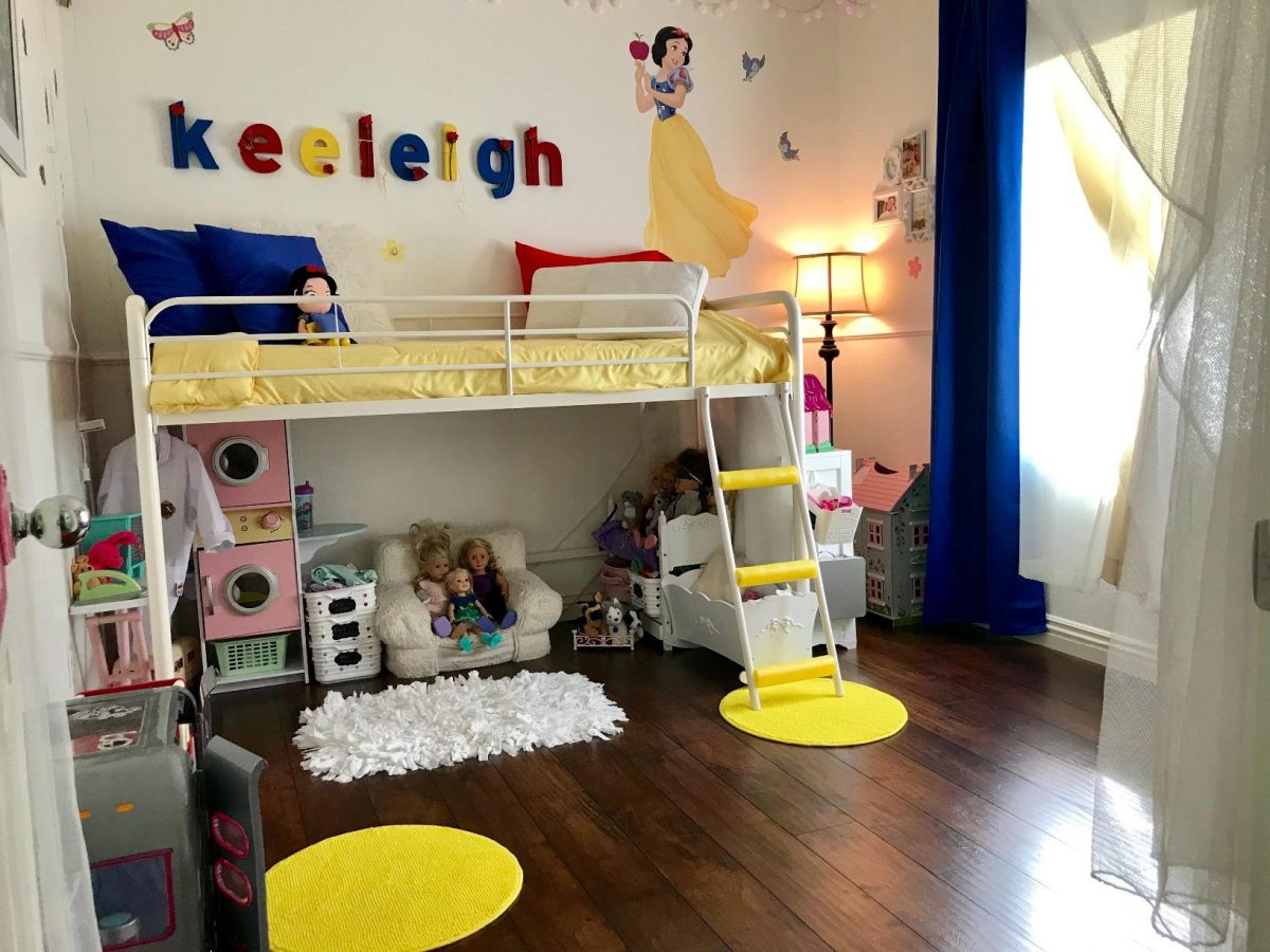 Adorable kids loft bed in white with toys stored under the bed