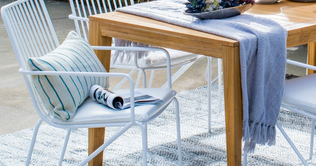 modern patio chairs next to outdoor table
