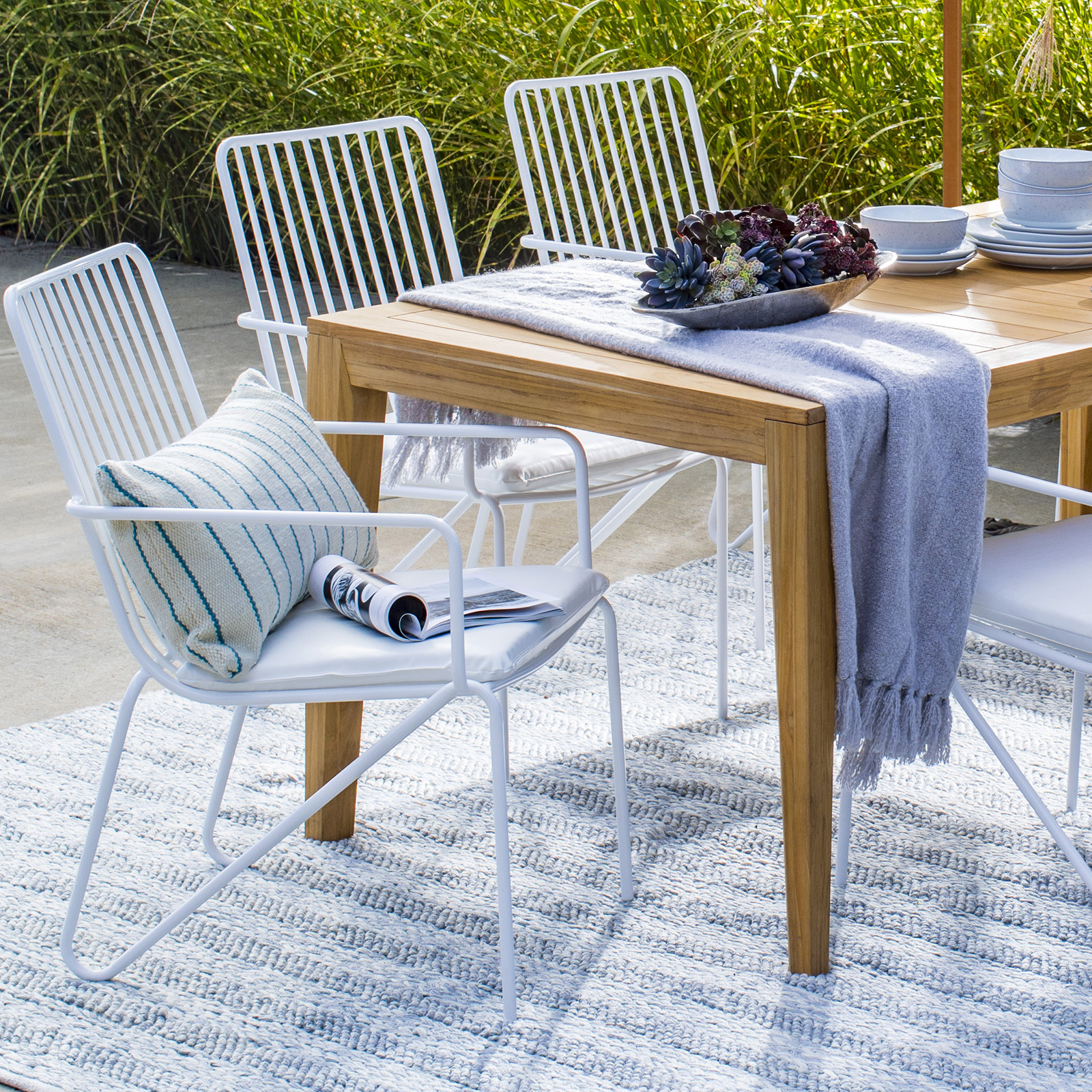 modern white patio chairs around outdoor table