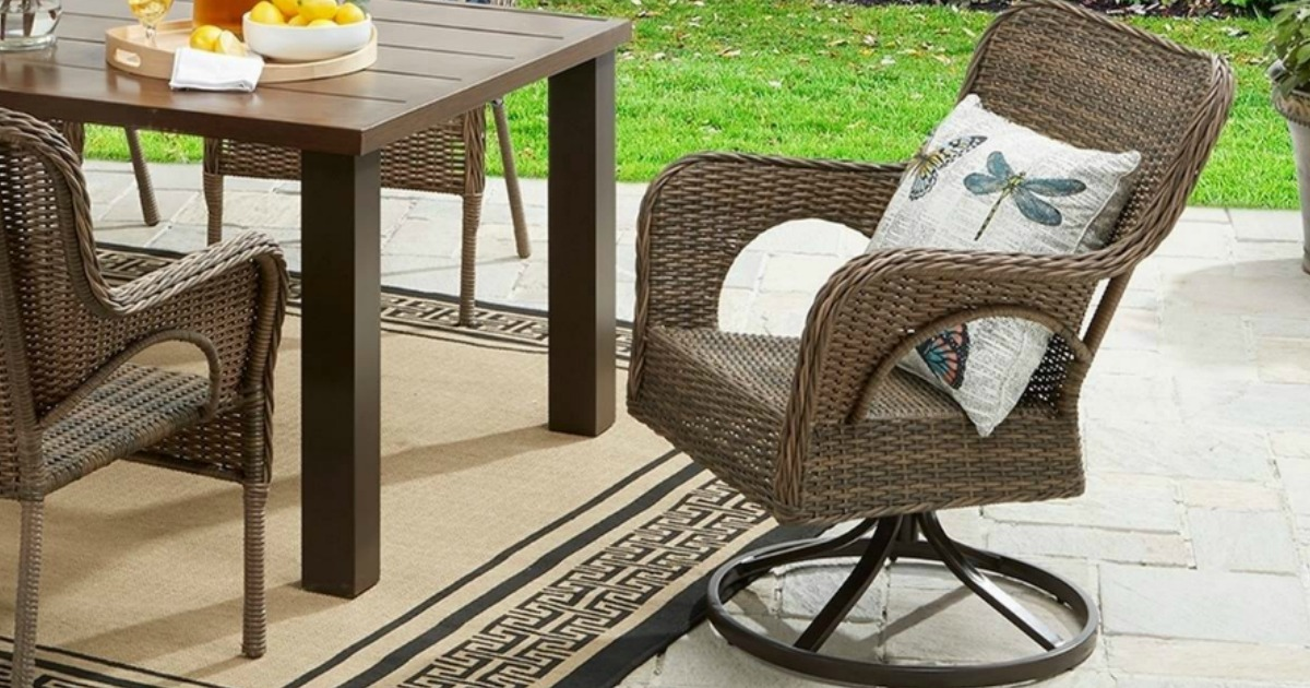 wicker patio swivel chair next to outdoor table